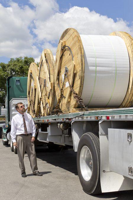 Truck bringing a load of Fiber-optic communication cable
