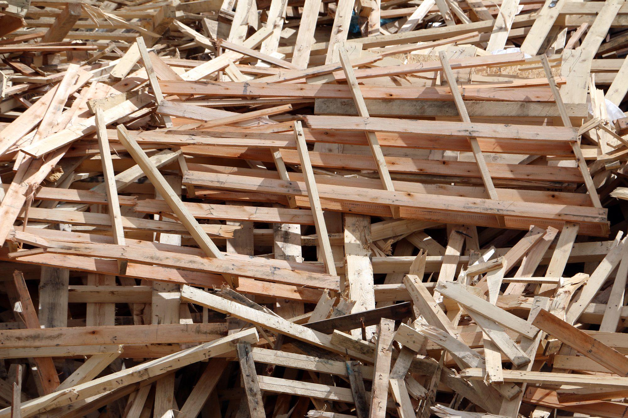 stacked wood pallets, broken