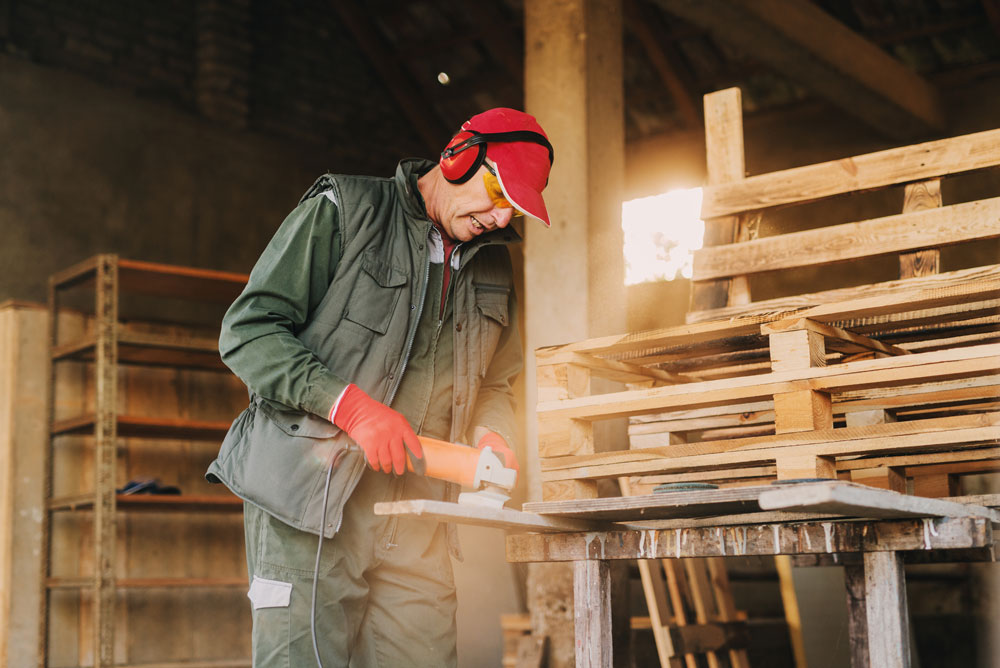 a man working on wood pallets